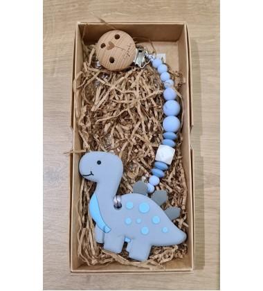 Šponkė Čiulptuko laikiklis su kramtuku-dinozauras. Spalva pilka / šviesiai mėlyna